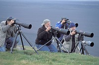 nature photographers fitted out with stativs and telelenses, Iceland