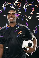 Smiling footballer and confetti