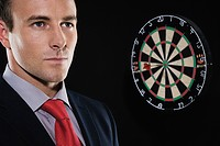Businessman and a dartboard