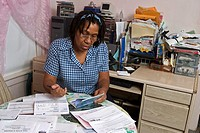 Detroit, Michigan - Homecare worker Virginia Burton pays her bills  Because of the low wages she receives from the state for taking care of two elderl...