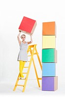 Woman with coloured boxes
