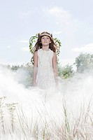 Girl dressed as fairy in cloud of smoke