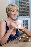 Woman in cafe with cup of tea