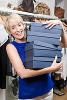 Woman in store with shoe boxes