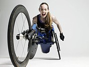 Overjoyed female wheelchair athlete