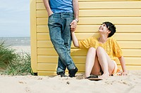 Young couple by beach hut