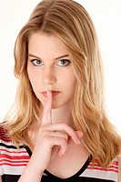Blonde woman holding finger on lips