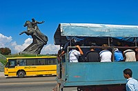 A people_carrying truck by the statue of Antonio Maceo in the Plaza de la Revolucion.