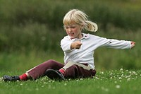 young girl playing in summer meadow, United Kingdom, Scotland