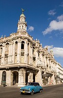 Old car driving past Gran Teatro de la Habana