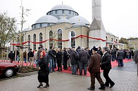 People leaving the Ditib_Merkez Mosque, biggest mosque in Germany, after the Friday prayer, Duisburg_Marxloh, North Rhine_Westphalia, Germany, Europe
