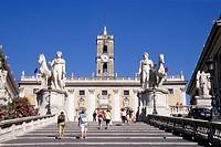 Tourists at Piazza del Campidoglio Square, dioscuri Castor and Pollux flanking the Cordonata, stairs leading to the Capitol, Senatorio Palace, Rome, I...