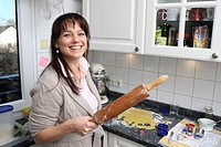 Housewife with rolling pin