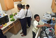 Detroit, Michigan - Dolores Dumas raises her grandchildren in a cramped public housing apartment in Detroit  She prepares dinner with her grandwon Edw...