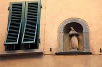 Window and statue, Volterra. Tuscany, Italy