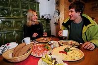 Skiers having a snack, brotzeit, in Hermagor, Tressdorfer Alm, Nassfeld, Kaernten, Austria, Europe