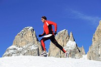 jogger in snowy mountain scenery