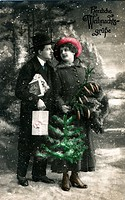 Historical German Christmascard, man and woman, snowy backdrop, Christmas tree and presents, Herzliche Weihnachtsgruesse