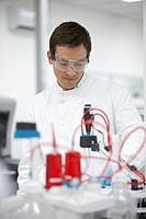 Scientist working with equipment in laboratory