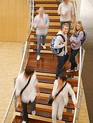 College students moving on staircase