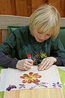 child doing blossom picture handicrafts