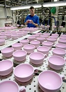 Employee checking cups in the warehouse of the crockery production, Villeroy & Boch AG Faiencerie, Merzig, Saarland, Germany, Europe