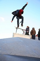 Jumping skateboarder with skateboard at skatepark in Amersfoort, The Netherlands