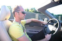 car Volvo C70 cabrio, convertible, driving on the road