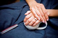 Close up of brides hands, wedding rings, bridal preparations