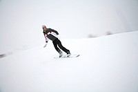Snowboarder in action during winter sports in the French Alps. Tarentaise, Savoy, Savoie, Peisey, Les Arcs / La Plagne, France.