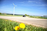 Wind turbine and Rape seeds oil flowers fields in the landscape of Northern Luxembourg, the Ardennes
