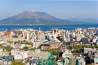 Overview on city of Kagoshima, volcano Sakurajima at back, Japan, aerial perspective