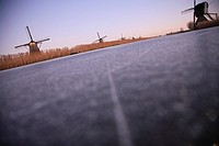 Dutch Kinderdijk windmills with ice in winter