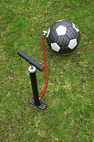 Air pump next to football awaiting inflation