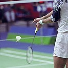 Close up of a badminton player ready to serve shuttlecock