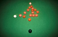 White ball breaking a rack of snooker balls