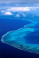 aerial photo of strait between Raiatea and Taha, French Polynesia