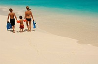 Woman and two children on the beach, Laguna Resort, The Maldives, Indian Ocean