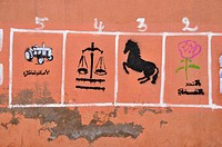 Moroccan vote advertising with the symbols of the various parties on a wall, Marrekech, Morocco, Africa