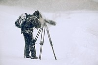 Nature photographer at work in the winter, North Tyrol, Austria, Europe