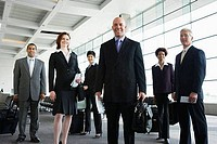 Business executives lining up to board an airplane