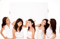 Five girls in white hold a large sign on white background