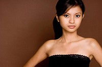 A cute young asian woman on brown background