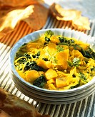 Potato curry with onions and spinach