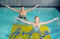 couple doing aquaerobic in pool