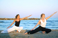 two women doing Tai Chi at the beach