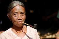 Smoking tattooed woman, so called spider women, Mrauk-U, Burma, also called Myanmar, Southeast Asia