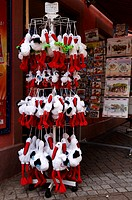 Plush or fluffy toy storks as souvenirs in Ribeauville, Alsace, France, Europe