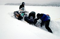 Snowmobile stuck in deep snow, Saguenay-Lac Saint Jean, Mont Valin Region, Quebec, Canada, North America