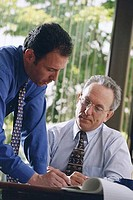 Two businessmen working in an office